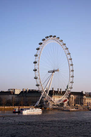 London, UK - March 04, 2011: View of the London Eye, a famous tourist attraction, seen from Hungerford Bridge