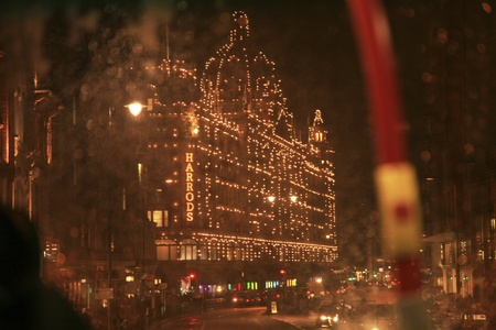 London, UK - December 15, 2010 : Night View of Harrods department store in the Brompton Road, near Knightsbridge Tube Station. This department store was opened at 1824 and now it is one of the most famous luxury store in London.