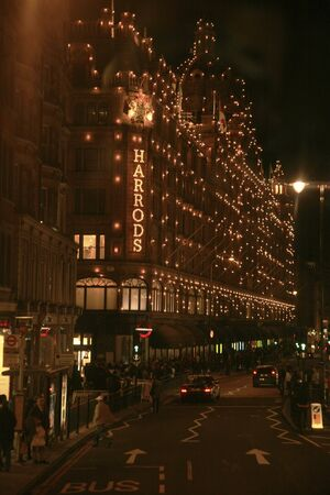 knightsbridge: London, UK - October 30, 2010 : Night View of Harrods department store in the Brompton Road, near Knightsbridge Tube Station. This department store was opened at 1824 and now it is one of the most famous luxury store in London.
