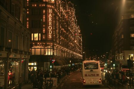 harrods: London, UK - October 30, 2010 : Night View of Harrods department store in the Brompton Road, near Knightsbridge Tube Station. This department store was opened at 1824 and now it is one of the most famous luxury store in London.