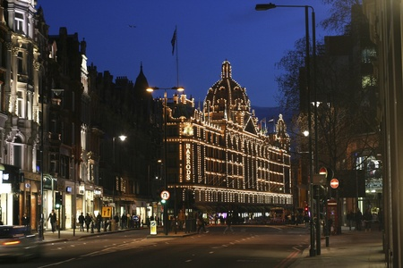 harrods: London, UK - April 4, 2010 : Night View of Harrods department store in the Brompton Road, near Knightsbridge Tube Station. This department store was opened at 1824 and now it is one of the most famous luxury store in London.  Editorial