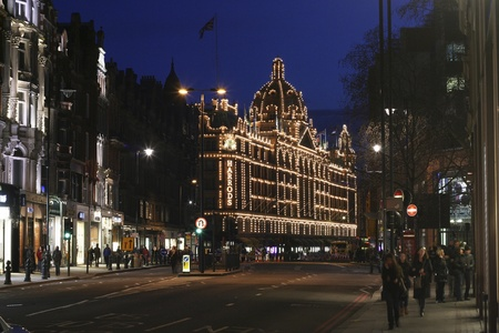 London, UK - April 4, 2010 : Night View of Harrods department store in the Brompton Road, near Knightsbridge Tube Station. This department store was opened at 1824 and now it is one of the most famous luxury store in London.