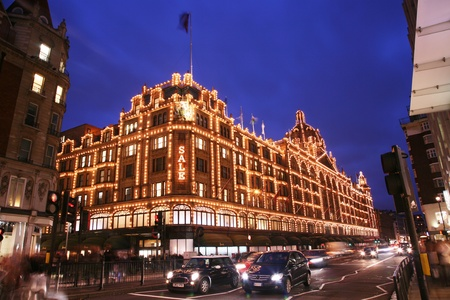 knightsbridge: London, UK - January 15, 2011 : Night View of Harrods department store in the Brompton Road, near Knightsbridge Tube Station. This department store was opened at 1824 and now it is one of the most famous luxury store in London.