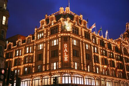 London, UK - January 15, 2011 : Night View of Harrods department store in the Brompton Road, near Knightsbridge Tube Station. This department store was opened at 1824 and now it is one of the most famous luxury store in London.
