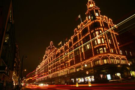 London, UK - January 15, 2011 : Night View of Harrods department store in the Brompton Road, near Knightsbridge Tube Station. This department store was opened at 1824 and now it is one of the most famous luxury store in London.  Stock Photo - 11215543