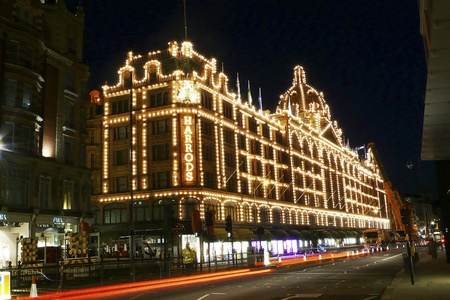 London, UK - April 5, 2010 : Night View of Harrods department store in the Brompton Road, near Knightsbridge Tube Station. This department store was opened at 1824 and now it is one of the most famous luxury store in London.
