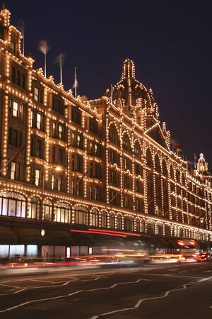 knightsbridge: Harrods, famous luxury department store, in London with Christmas Decoration.