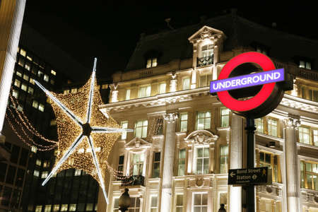 oxford street: London, UK - November 15, 2011: Street Night View of Oxford Street with Christmas Decoration. Oxford Street is one of the most famous shopping street in London. Editorial