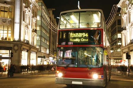 oxford street: Double Decker Bus, most iconic symbol of London, in Oxford Street at Night.  Editorial