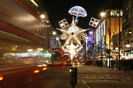 London, UK - November 17, 2011: Christmas Lights Display on Oxford Street in London. The modern colourful Christmas lights attract and encourage people to the street.
