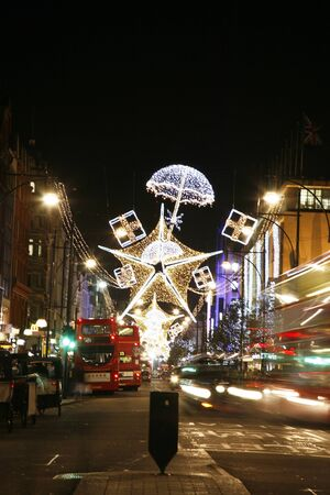 London, UK - November 17, 2011: Christmas Lights Display on Oxford Street in London. The modern colourful Christmas lights attract and encourage people to the street.  Stock Photo - 11240967