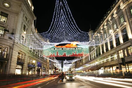 London, UK - November 17, 2011: Christmas Lights Display on Regend Street in London. The modern colourful Christmas lights attract and encourage people to the street. Stock Photo - 11240991