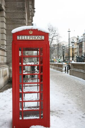 Red phone booth is one of the most famous icons of London photo