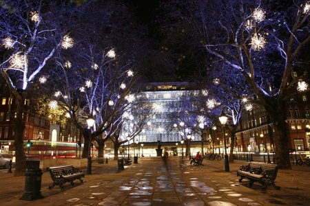 Christmas Lights Display on Sloane Square in Chelsea, London. The modern colourful Christmas lights attract and encourage people to the street.    Stock Photo - 11411605