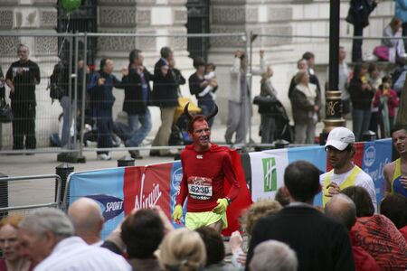majors: London, UK - April 25, 2010: Participant in the London Marathon wearing funny costume. The London Marathon is next to New York, Berlin, Chicago and Boston to the World Marathon Majors, the Champions League in the marathon.   Editorial