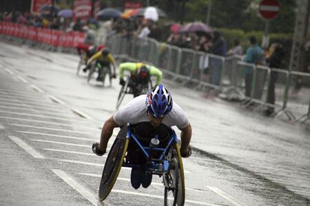 London, UK - April 25, 2010: Wheelchair racing contestants in the London Marathon. The London Marathon is next to New York, Berlin, Chicago and Boston to the World Marathon Majors, the Champions League in the marathon.