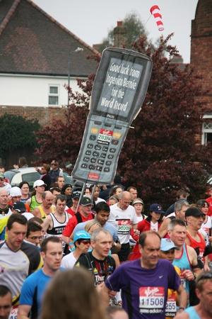 London, UK - April 25, 2010: Runners in the London Marathon. The London Marathon is next to New York, Berlin, Chicago and Boston to the World Marathon Majors, the Champions League in the marathon.   Stock Photo - 11581326