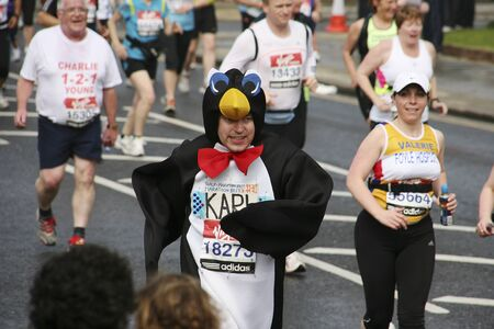 London, UK - April 25, 2010: Participant in the London Marathon wearing funny costume. The London Marathon is next to New York, Berlin, Chicago and Boston to the World Marathon Majors, the Champions League in the marathon.  Stock Photo - 11581330