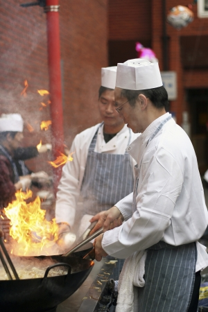 London, UK - February 18, 2007: Chinese chefs work at the Chinese New Year celebrations in Londons Chinatown.