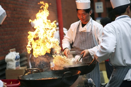 London, UK - February 18, 2007: Chinese chefs work at the Chinese New Year celebrations in London's Chinatown.