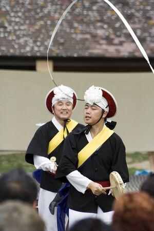 London, UK - August 15, 2009: Korean ethnic dancers perform, Nongak, farmers' dance, in the Korean Festival on August 15, 2009 in London, UK.  Stock Photo - 11653776