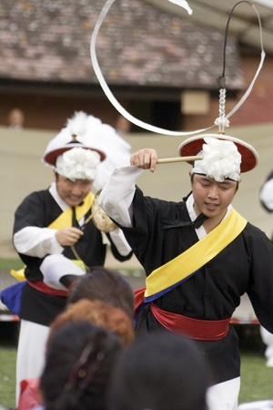 London, UK - August 15, 2009: Korean ethnic dancers perform, Nongak, farmers dance, in the Korean Festival on August 15, 2009 in London, UK.