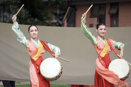 London, UK - August 15, 2009: Korean ethnic dancers perform, Jindo Bukchum, drum dance, in the Korean Festival on August 15, 2009 in London, UK.