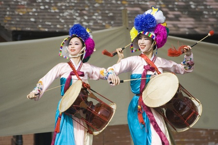 London, UK - August 15, 2009: Korean ethnic dancers perform, Jangguchum, dance with janggu, hourglass-shaped drum, in the Korean Festival on August 15, 2009 in London, UK.