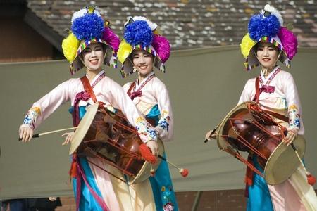 London, UK - August 15, 2009: Korean ethnic dancers perform, Jangguchum, dance with janggu, hourglass-shaped drum, in the Korean Festival on August 15, 2009 in London, UK.   Stock Photo - 11653777