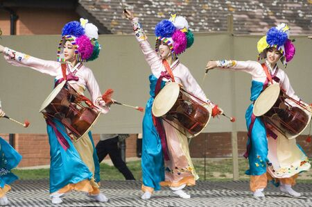 London, UK - August 15, 2009: Korean ethnic dancers perform, Jangguchum, dance with janggu, hourglass-shaped drum, in the Korean Festival on August 15, 2009 in London, UK.   Stock Photo - 11653790