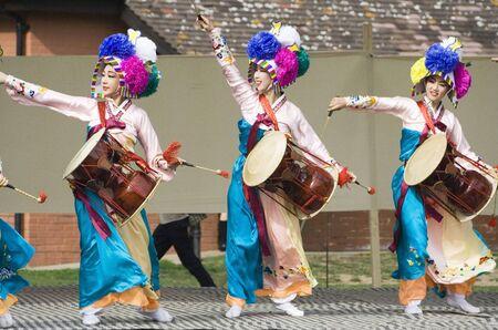 London, UK - August 15, 2009: Korean ethnic dancers perform, Jangguchum, dance with janggu, hourglass-shaped drum, in the Korean Festival on August 15, 2009 in London, UK.   Stock Photo - 11653790