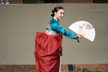 London, UK - August 15, 2009: Korean ethnic dancers perform, Buchaechum, fan dance, in the Korean Festival on August 15, 2009 in London, UK.