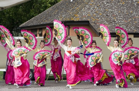 cultural and ethnic clothing: London, UK - August 15, 2009: Korean ethnic dancers perform, Buchaechum, fan dance, in the Korean Festival on August 15, 2009 in London, UK.