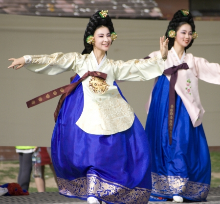 korean fashion: London, UK - August 15, 2009: Korean ethnic dancers perform, Taepyeongmu, dance to wish great peace, in the Korean Festival on August 15, 2009 in London, UK.