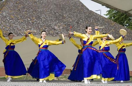 London, UK - August 15, 2009: Korean ethnic dancers perform, Hand Drum Dance, drum dance, in the Korean Festival on August 15, 2009 in London, UK.