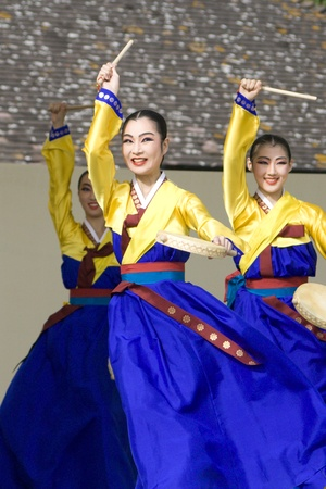 London, UK - August 15, 2009: Korean ethnic dancers perform, Hand Drum Dance, drum dance, in the Korean Festival on August 15, 2009 in London, UK.