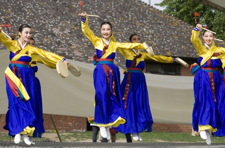korean fashion: London, UK - August 15, 2009: Korean ethnic dancers perform, Hand Drum Dance, drum dance, in the Korean Festival on August 15, 2009 in London, UK.