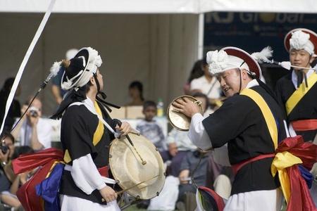 London, UK - August 15, 2009: Korean ethnic dancers perform, Nongak, farmers