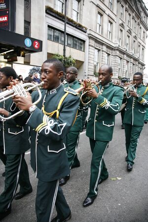 London, UK - January 01, 2012: Marching Band participate in the New Years Day Parade. More than 10,000 performers represent for 20 countries world-wide like marching bands, cheerleaders, clowns acrobats etc.  Stock Photo - 11728574