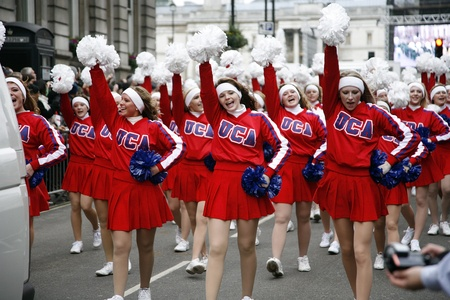 London, UK - January 01, 2012: American Cheerleaders participate in the New Years Day Parade. More than 10,000 performers represent for 20 countries world-wide like marching bands, cheerleaders, clowns acrobats etc.