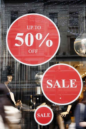 clearance: Sale signs in shop window, big reductions