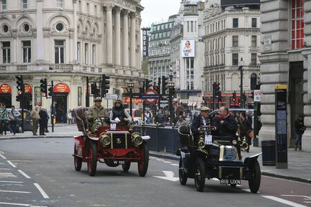 london to brighton veteran car run: London, UK - November 06, 2010: London to Brighton Veteran Car Run participants drive around Piccadilly Circus to be in Londons Regent Street to display their vintage cars on the day before the run.