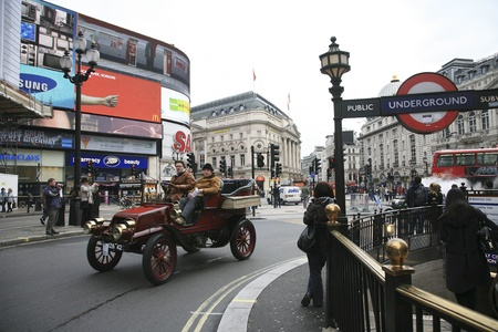 london to brighton veteran car run: London, UK - November 06, 2010: London to Brighton Veteran Car Run participants, Winton, 1904, drive around Piccadilly Circus to be in Londons Regent Street to display their vintage cars on the day before the run.     Editorial