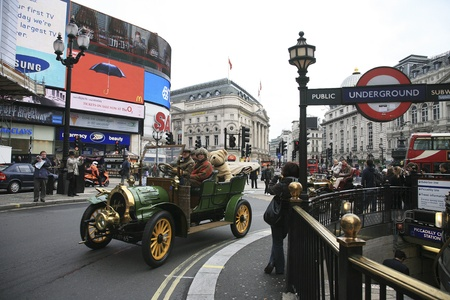 London, UK - November 06, 2010: London to Brighton Veteran Car Run participants, Spyker, 1905, drive around Piccadilly Circus to be in London's Regent Street to display their vintage cars on the day before the run.     Stock Photo - 11988107