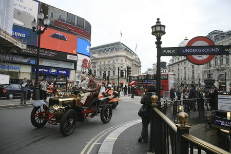 london to brighton veteran car run: London, UK - November 06, 2010: London to Brighton Veteran Car Run participants, Darracq, 1904, drive around Piccadilly Circus to be in Londons Regent Street to display their vintage cars on the day before the run.
