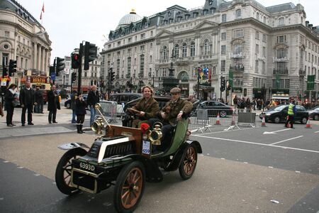 london to brighton veteran car run: London, UK - November 06, 2010: London to Brighton Veteran Car Run participants, De Dion Bouton, 1904, drive around Piccadilly Circus to be in Londons Regent Street to display their vintage cars on the day before the run.