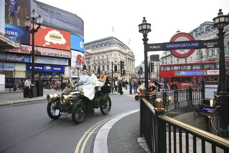 london to brighton veteran car run: London, UK - November 06, 2010: London to Brighton Veteran Car Run participants, Panhard-Levassor, 1903, drive around Piccadilly Circus to be in Londons Regent Street to display their vintage cars on the day before the run.