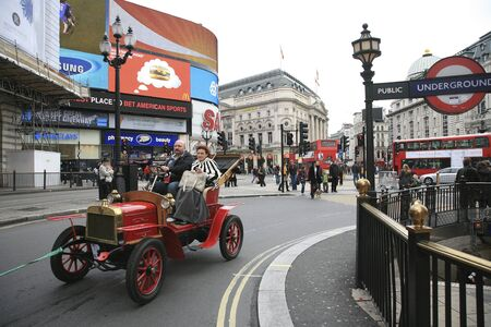 london to brighton veteran car run: London, UK - November 06, 2010: London to Brighton Veteran Car Run participants, Laurin Klement, drive around Piccadilly Circus to be in Londons Regent Street to display their vintage cars on the day before the run.