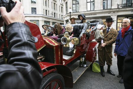 London, UK - November 06, 2010: Display of vintage cars, Renault, 1902. Some participants display their old cars in Londons Regent Street on the day before the Run.
