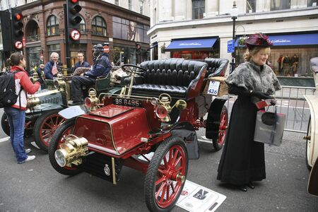 london to brighton veteran car run: London, UK - November 06, 2010: Display of vintage cars, Cadilac, 1904. Some participants display their old cars in Londons Regent Street on the day before the Run.
